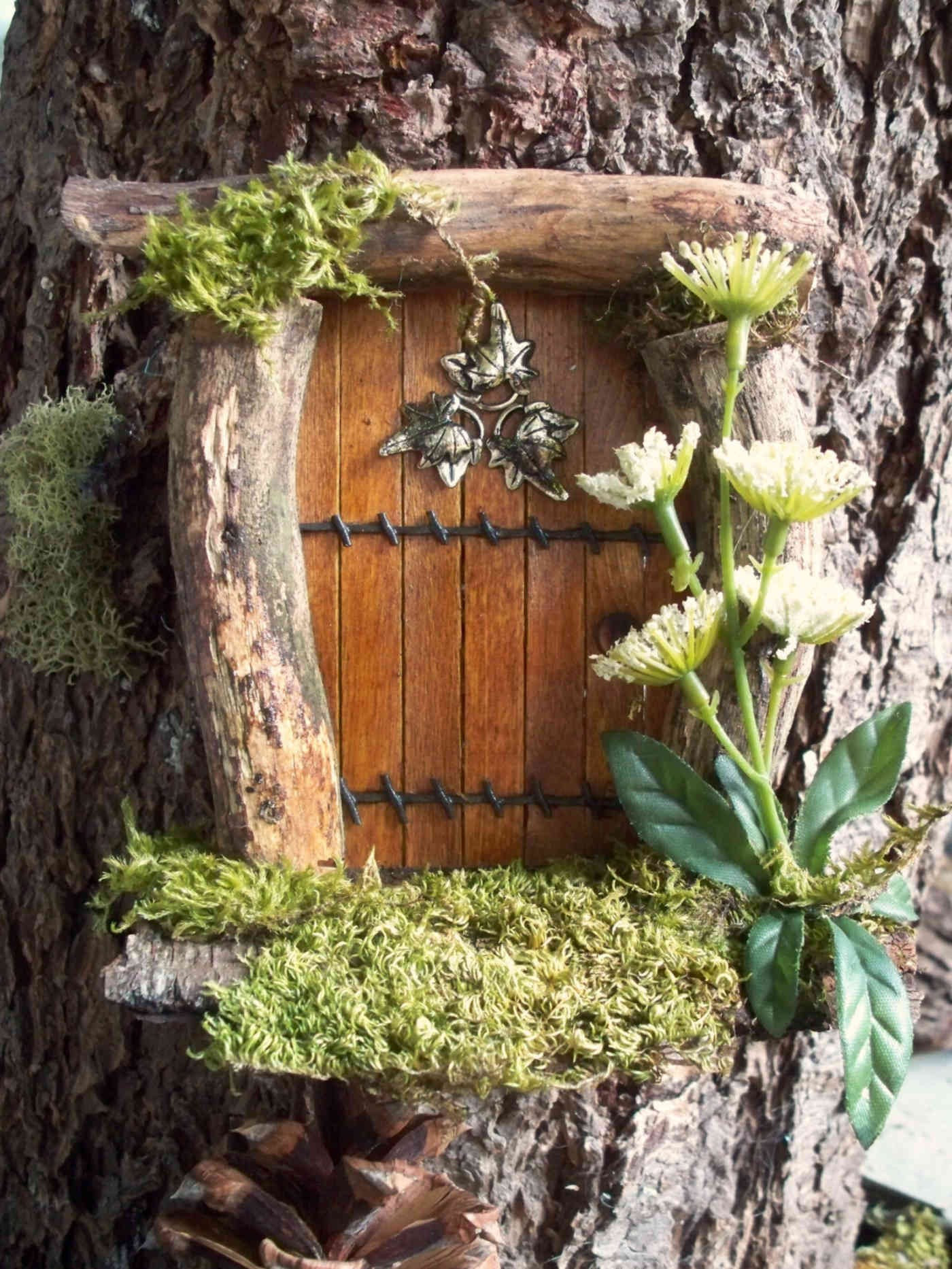 Small Scale Doors placed on trees, turning them into Faerie houses 3
