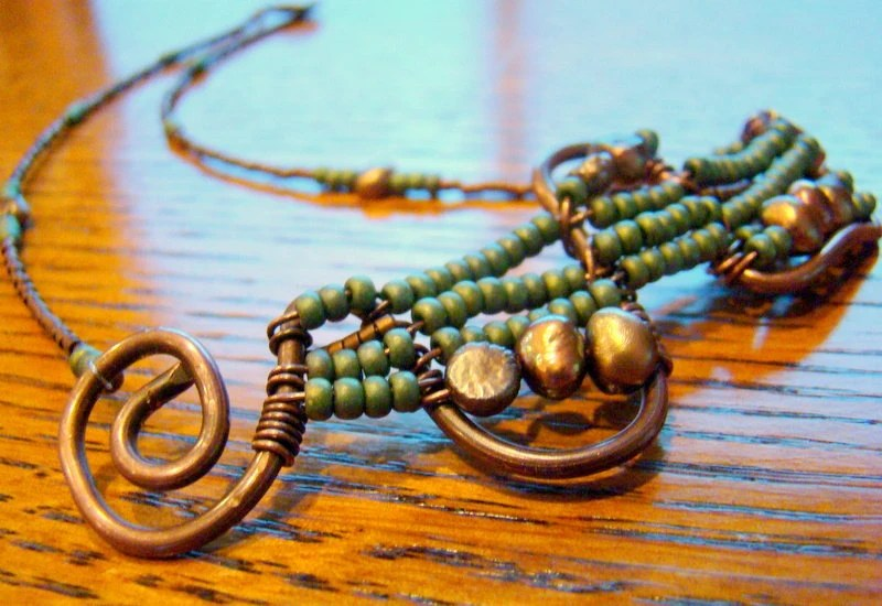 Copper Metalwork Necklace: oxidized copper with wire wrap green turquoise raku style glass beads