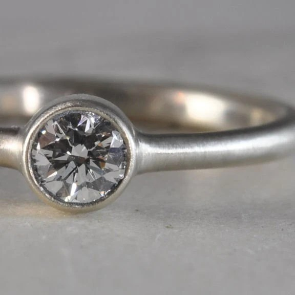 Diamond bezel ring - 0.23 carats, 14k white gold
