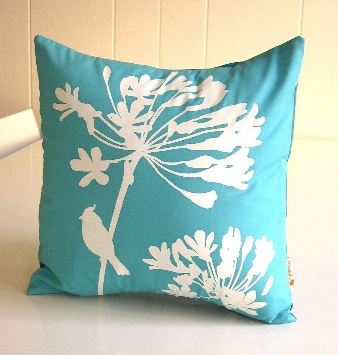 Aqua Blue Cardinal on Agapanthus pillow from joom.etsy.com