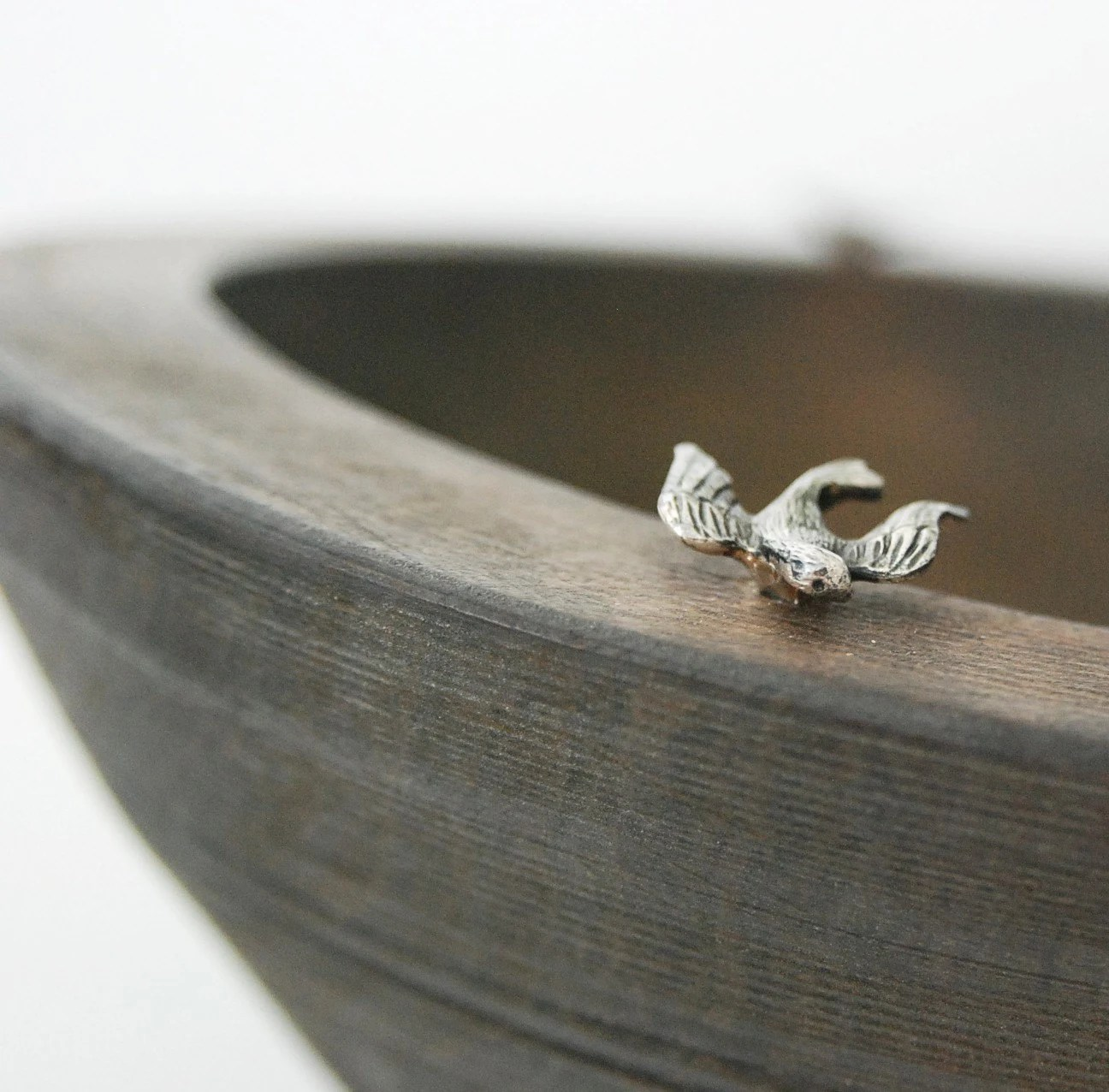 Wooden bowl with three sterling silver birds on top