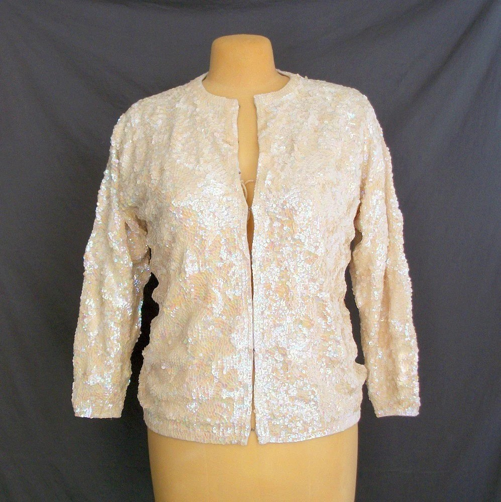 Iridescent Sequin Sweater. L. Cream.