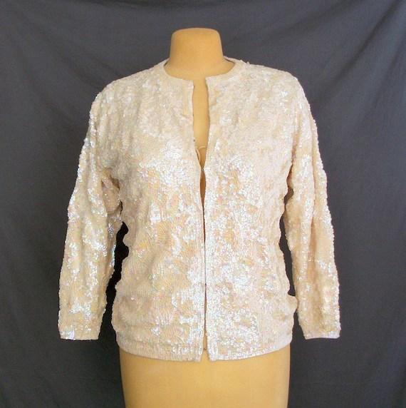 Iridescent Sequin Sweater. L. Cream.