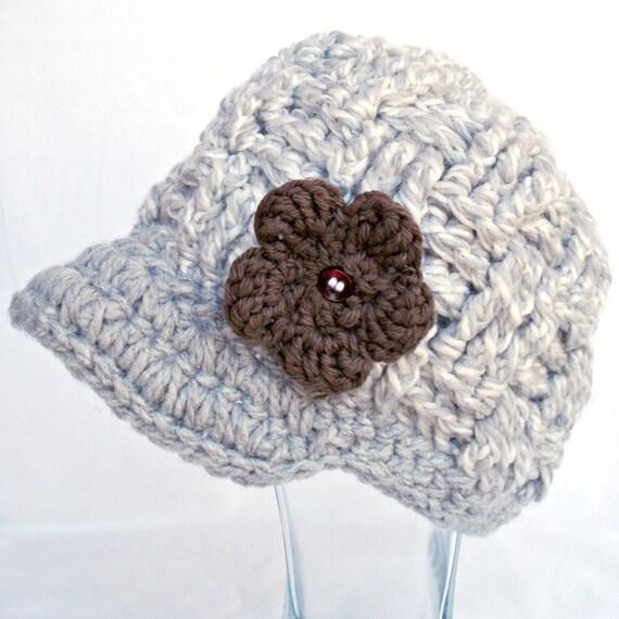 Gray/white crochet newsboy with brown crochet flower