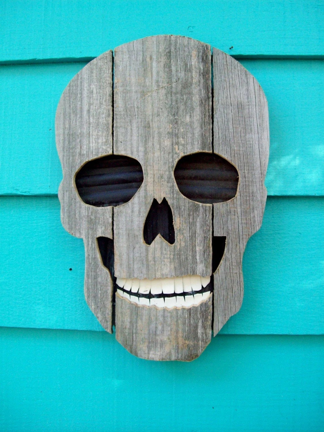 Large skull made of recycled wood and plastic