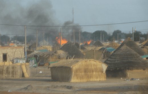 burning tukuls in a South Sudan village....