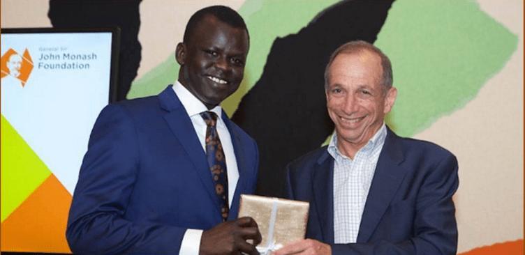 Dr Garang Dut  being awarded 2017 John Monash Harvard Scholarship at John Monash Foundation(Photo: supplied)