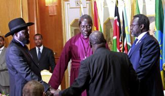 President Salva Kiir and his former Vice President Riek Machar join hands for a moment of prayers lead by South Sudan Anglican Bishop in Addis Ababa, Ethiopia.