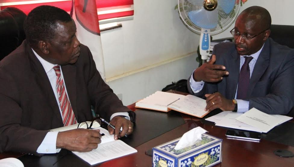 Photo caption: NCAC Chair Gichira Kibara (right) with Justice and Constitutional Affairs Minister, Paulino Wanawila on Wednesday.