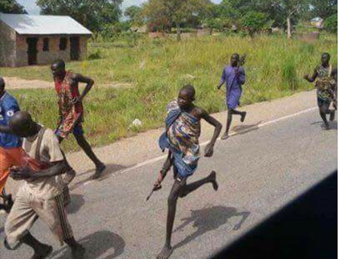 A group of young South Sudanese fighters escaping for their lives after a fierce battle in South Sudan civil war(Photo credit: unknown)