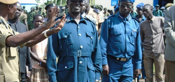 Inspector General of Police Kale Kayihura (L) and South Sudan counterpart Gen Pieng Deng (C) at the launch of the joint patrol at Afoji border this week. PHOTO BY SCOVIA ICETA ….