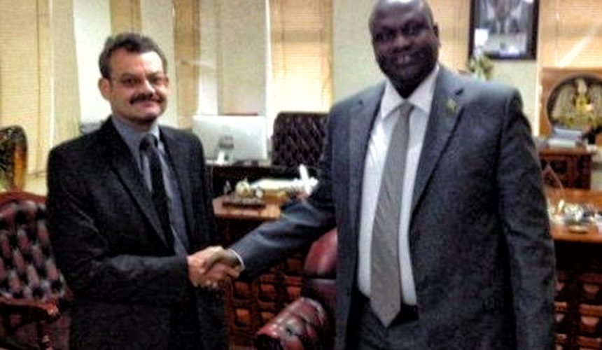 South African Ex-Colonel William John Endley  posts for a picture with Sudan's First Vice President, Dr. Riek Machar Teny in the past(Photo: Linked-in profile)