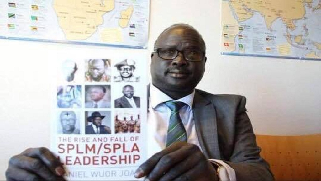 Late Hon. Daniel Wuor Joak holding his booth, the Rise and Fall of SPLM/A Leadership(Photo: supplied)