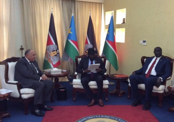 South Sudan troubled President desperately scans through a friendly letter from the Egyptians' president to see his chances of joining the Arab League. Next to the right of Salva Kiir is the Egyptian Foreign Minister Sameh Shukry who brought the letter(Photo: file)