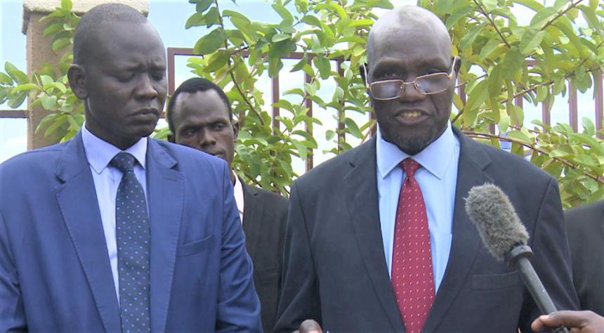 Chairman of the little-known opposition group and the head of delegation speaking to the media upon arrival at Juba Airport (Photo credit: SSDN Presidential Unit)