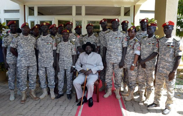 JUBA, SOUTH SUDAN - DECEMBER 28: South Sudanese President Salva Kiir Mayardit (C) poses family photo with the members of Presidential Guard during a meeting at the Presidential Palace in Juba, South Sudan on December 28, 2014. (Photo by Samir Bol/Anadolu Agency/Getty Images)