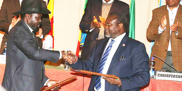 President Salva Kiir (left) and SPLM-IO leader Riek Machar shake hands after signing a peace pact in Addis Ababa during an extraordinary AU Summit in 2015(Photo: file)