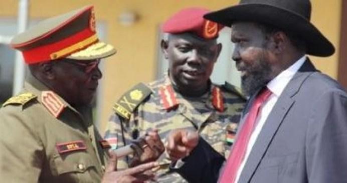 Former SPLA Chief of General Staffs Gen. Paul Malong Awan (R) Speaks with President Kiir in Juba 2015 (File photo)