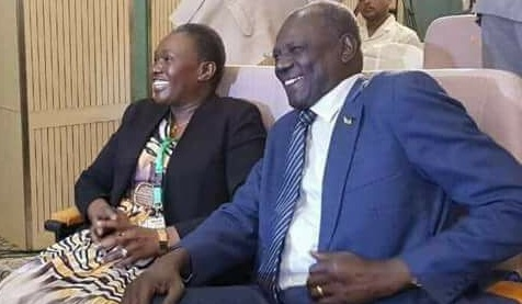 Mama Angelina Teny, the SPLM-IO Chairperson of National Committee for Defense (L) and the government information minister and spokesman Michael Makuei Lueth (R) smile as they were about to sign the security arrangement (File photo)