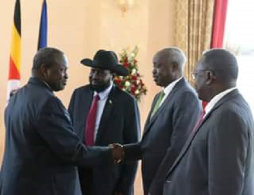Dr. Riek Machar as he meets president Kiir in Kampala (File photo)