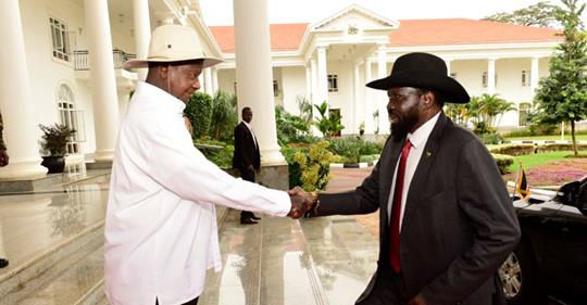 South Sudanese President (in cowboy hat) greets his Ugandan counterpart as he arrive this morning from his hotel room to the State House Entebbe for a secret meeting with the Ugandan leader (File Photo)