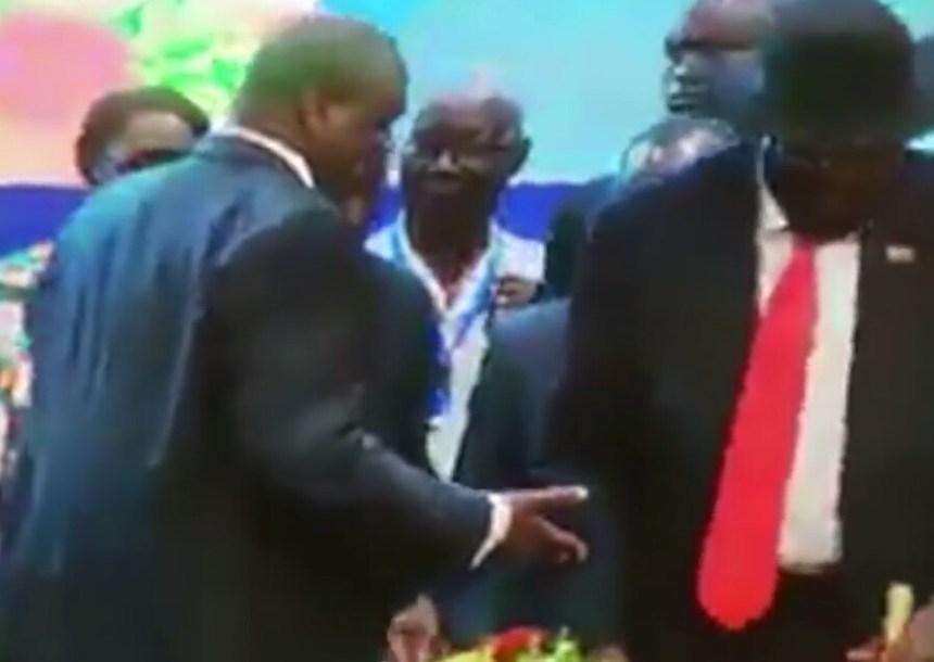 President appears snubbing a handshake from opposition leader Dr. Riek Machar in Khartoum (File photo)