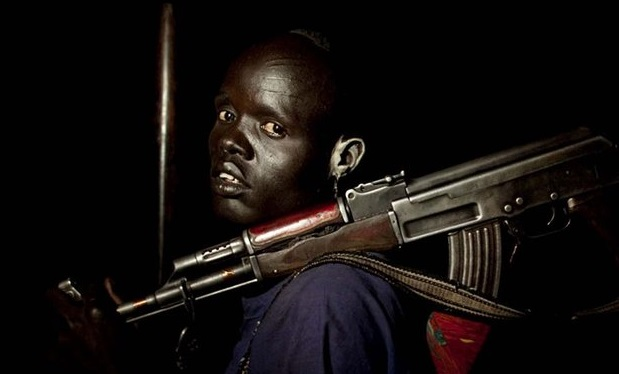 A man seen caring his AK-47 ripple in an unknown location in South Sudan (File photo)