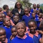 NYAPE - Dr. Linda Patterson with the children of Gikumene Primary School in Kenya