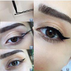 les épingles aident à trace l'eyeliner