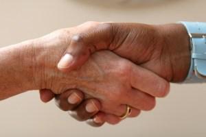 A firm handshake between two people.