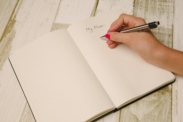 A girl making a list that can helpyouplan and organize your NYC move