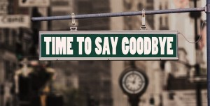 Time to say goodbye sign on a building.