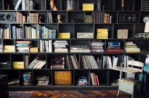 Large black shelves filled with books.