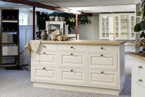 A kitchen desk with many drawers.
