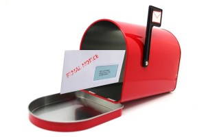 Final notice envelope in a mailbox