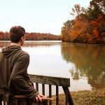 A young man looking at the lake in Cookeville, TN
