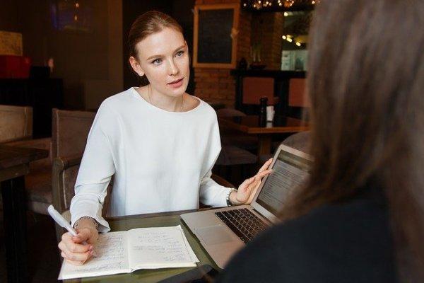 Two businesswomen talking.