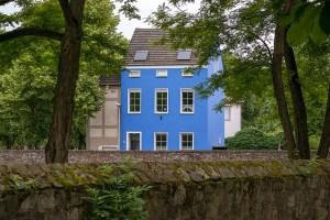 A blue multi-family home.