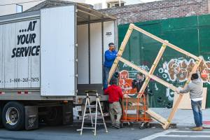 A moving crew loading the truck.