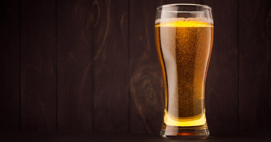 Cider glass on a wood background