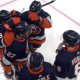 Islanders celebrate goal against sabres