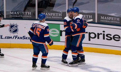 New York Islanders Center Casey Cizikas (53) and New York Islanders Right Wing Cal Clutterbuck (15) congratulate New York Islanders Left Wing Matt Martin (17) for scoring a goal during the third period of the National Hockey League game between the Buffalo Sabres and the New York Islanders on March 4, 2021, at the Nassau Veterans Memorial Coliseum in Uniondale.