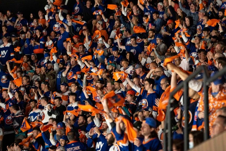 UNIONDALE, NY - JUNE 03: New York Islanders fans cheer during the third period of Game 3 of the NHL Stanley Cup Playoffs Second Round between the Boston Bruins and the New York Islanders on June 3, 2021, at the Nassau Coliseum in Uniondale, NY. (Photo by Gregory Fisher/Icon Sportswire)