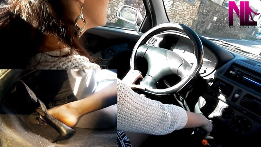 driving-in-black-patterned-leather-worn-out-pumps