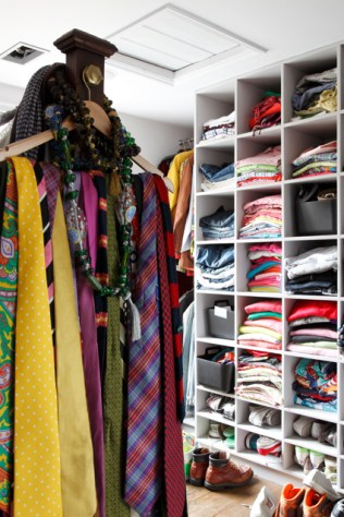 A bedroom has been turned into a closet.
