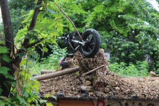 overturned motorcycle in debris