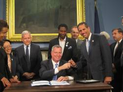 The Tenants Bill of Rights is signed into law.  (l to r) Council Member Margaret Chin, Council Member Jimmy Van Bramer, Mayor Bill de Blasio, Council Member Jumaane D. Williams, and Council Member Fernando Cabrera.  Image credit:  Office of Council Member Fernando Cabrera