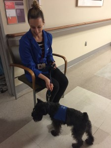 Kristin with Echo, a dog that visits patients