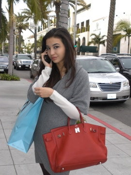 Manohara with Red Hermes Bag