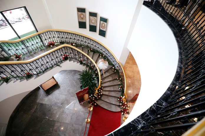 A dancer walks down the stair at the newly inaugurated Dolce Hanoi Golden Lake luxury hotel in Hanoi